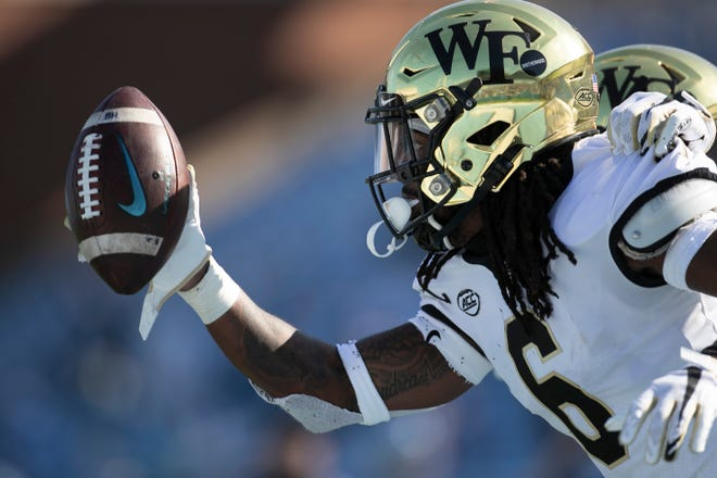 Wake Forest defense back Ja'Sir Taylor (6) celebrates after intercepting a pass by North Carolina quarterback Sam Howell in the second quarter at Kenan Stadium on Saturday, November 14, 2020 in Chapel Hill, N.C