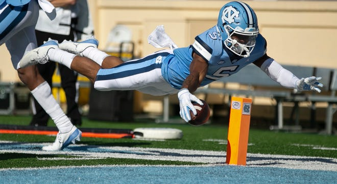 North Carolina receiver Dazz Newsome dives for the end zone against Wake Forest during Saturday's game in the ACC at Kenan Stadium.