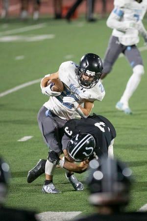 South High School's Luke Guarienti, right, makes an open field tackle on Vista Ridge's Beaux Wojciechowski on Friday at Dutch Clark Stadium. [Chieftain photo/Zachary Allen]