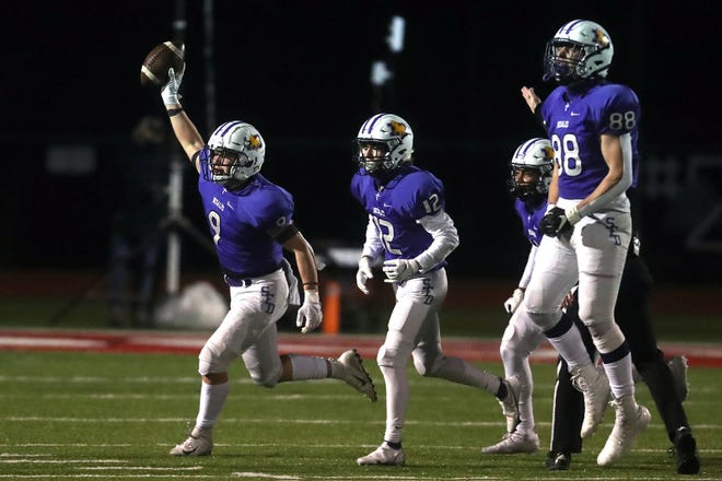 DeSales' Jason Velazquez II (9) runs off the field with teammates Matteo Cua (12), Rechee Smith and Braden Jehn (88) after recovering a fumble during a 23-13 win over Kettering Alter in a Division III state semifinal Nov. 13 at London.