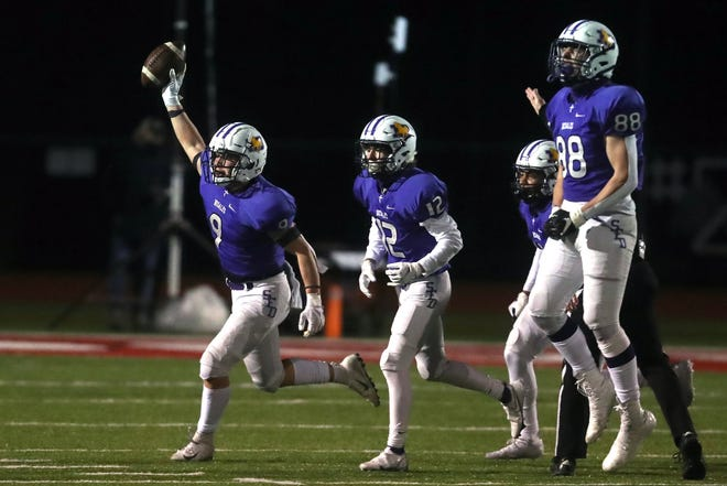 DeSales' Jason Velazquez II (9) runs off the field with teammates Matteo Cua (12), Rechee Smith (19) and Braden Jehn (88) after recovering a fumble in a Division III state semifinal against Kettering Alter on Nov. 13 at London. The Stallions won 23-13.