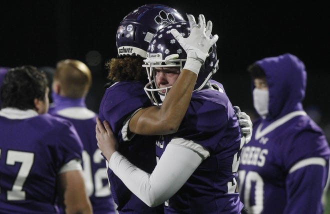 Pickerington Central's Isaiah Henderson, left, and Mitchell Vollmer console one another after the Tigers fell to Cincinnati St. Xavier 44-3 in the Division I state final Nov. 13 at Fortress Obetz.