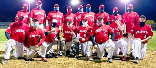 Alibrandi's, Somerville's Boston Men's Senior Baseball League representative, are shown posing with the championship trophy after beating the Bistro 781 Bulls recently. It's their first title since 2016. They are, from left, front row, Ted Tracy, Rich Winant, Chris Deane, Jay Hussey, Jason DeMattia, Dan Jalbert, Dana Levensaler and Billy Brooks. Top row, Rocky MacDonald, Mike Navarro, Steve Walsh, Dave Mitrou, Hugh Cornwell, John Jones, Jon Miarecki, J.P. Songin and manager Mike Powers.