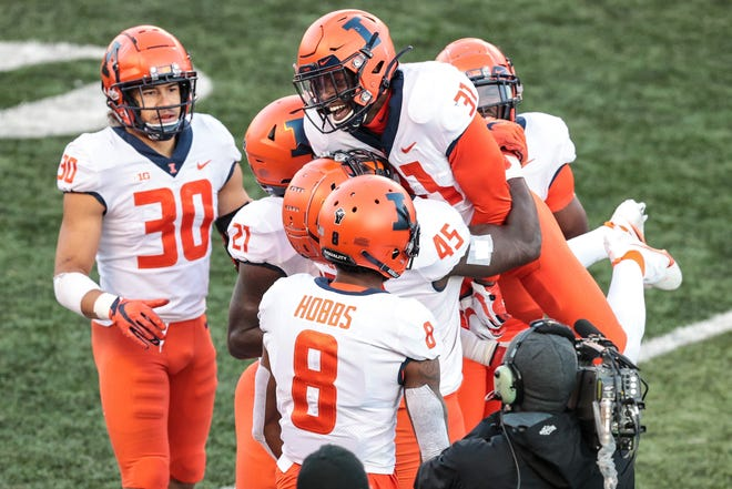 Nov 14, 2020; Piscataway, New Jersey, USA; Illinois Fighting Illini defensive back Devon Witherspoon (31) celebrates his interception against the Rutgers Scarlet Knights with teammates during the second half at SHI Stadium.