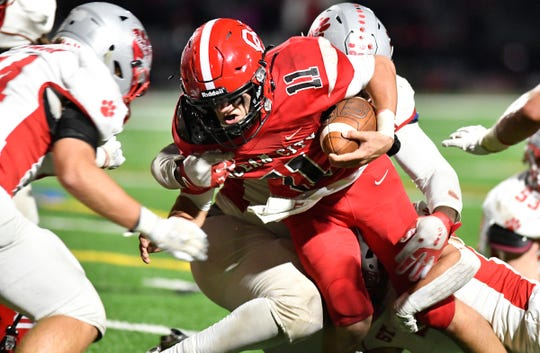 Ocean City's Joe Repetti runs for a gain against St. Joseph Academy on Friday night in a WJFL Pod B matchup. The Raiders topped the visiting Wildcats 12-7 on Nov. 13, 2020.