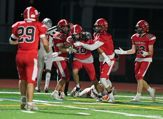 Ocean City celebrates a last-minute interception by Brady Rauner that sealed the seventh-ranked Red Raiders' 12-7 triumph over visiting No. 5 St. Joseph on Friday, Nov. 13, 2020.
