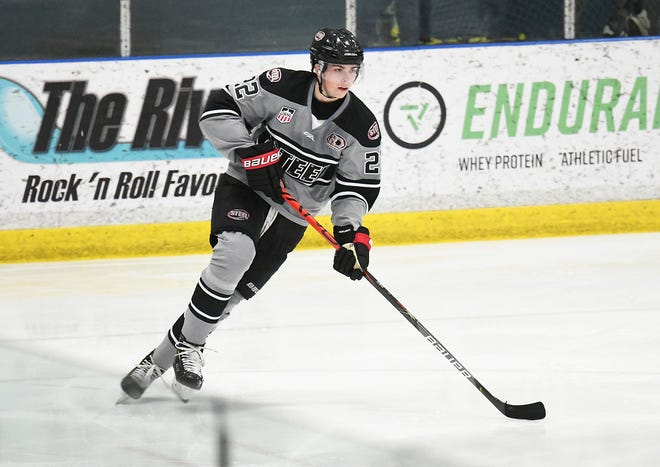 Former Chicago Steel defenseman Owen Power had one goal and two assists in his debut with the University of Michigan on Saturday.