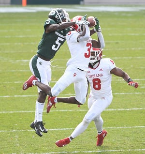 Indiana's Tiawan Mullen intercepts a pass intended for Michigan State's Jayden Reed, thrown by quarterback Rocky Lombardi, in the second quarter. Lombardi did not come back out in the second quarter, with Michigan State's Payton Thorne taking over the quarterback position.
