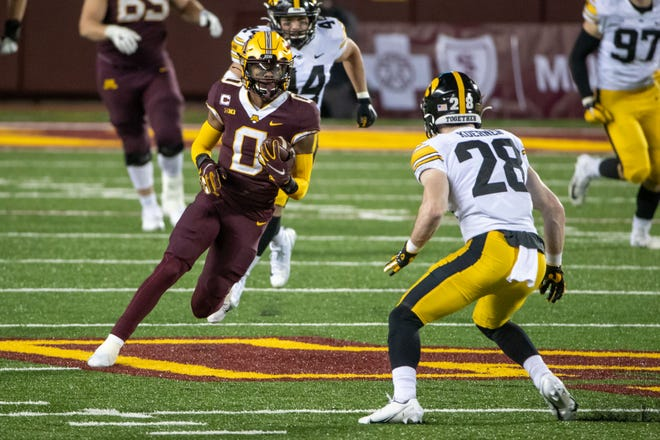 Minnesota wide receiver Rashod Bateman (0) runs with the ball after making a catch against Iowa. Bateman is considered a first-round talent and could be on the Browns' radar at No. 26. [Jesse Johnson/USA TODAY Sports]