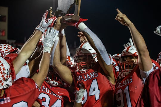 The Center Grove Trojans celebrate a Class 6A Regional Championship after defeating the Warren Central Warriors 38-0 at Center Grove High School in Greenwood, Ind., on Friday, Nov. 13, 2020.