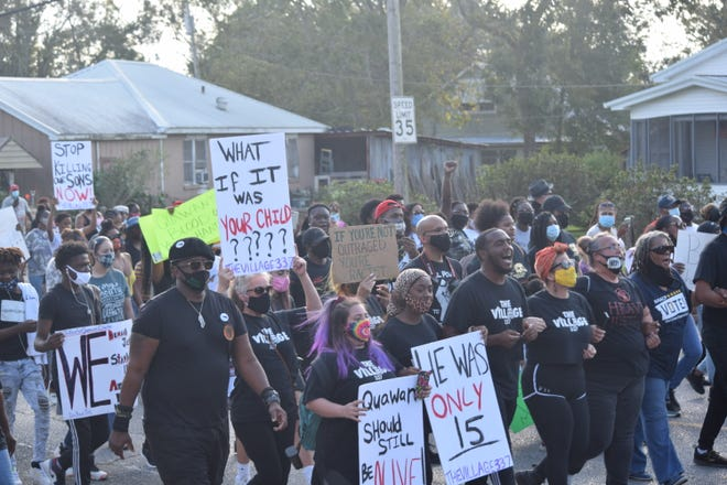 """The family of Quawan """"Bobby"""" Charles, local activists and community members march in the streets of Baldwin, Louisiana, on Nov. 14, 2020, to demand justice and a transparent investigation into the 15-year-old's death."""