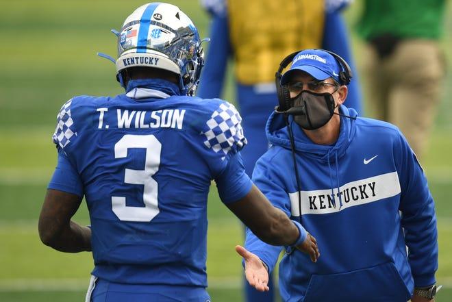 UK offensive coordinator Eddie Gran congratulates quarterback Terry Wilson after a touchdown pass during the University of Kentucky football game against Vanderbilt at Kroger Field in Lexington, Kentucky, on Saturday, Nov. 14, 2020.