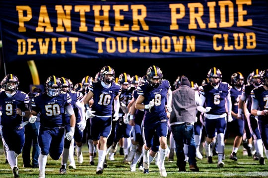 DeWitt takes the field before the game against Mason on Friday, Nov. 13, 2020, at DeWitt High School.