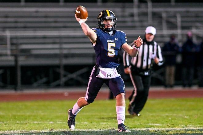 DeWitt's Tyler Holtz throws a pass against Mason during the first quarter on Friday, Nov. 13, 2020, at DeWitt High School.