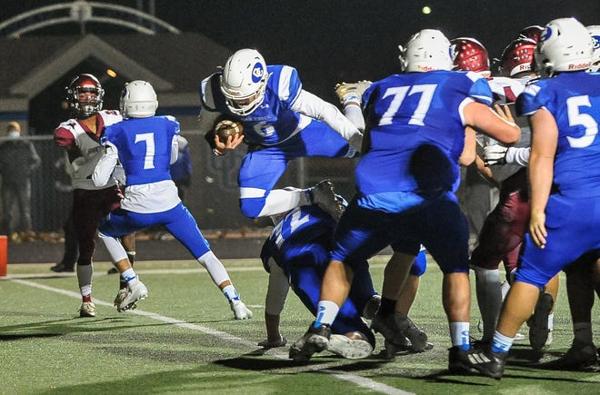 Oak Creek quarterback Cade Palkowski (6) has led the Knights to a 6-0 record and their first appearance in the Associated Press top 10.
