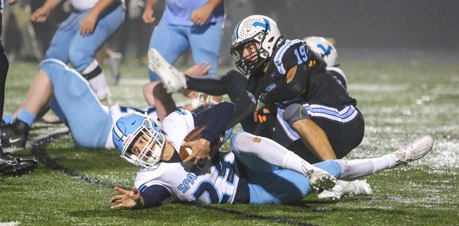 Sparta freshman Josh Brancy is taken down by Parsippany Hills' Aidan Caravello during the first half of a football game at Parsippany Hills High School on November 13, 2020. Alexandra Pais/ For the Daily Record
