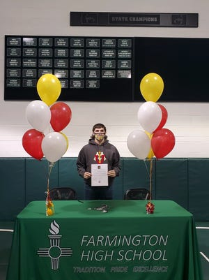Farmington's Zack Small signs his National Letter of Intent on Saturday, Nov. 14, 2020 to continue his wrestling career at NCAA Division I Virginia Military Institute.