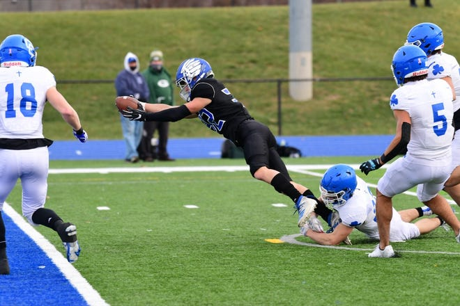 Lakeland senior Mike Sherrill reaches for the end zone for the Eagles' first score.