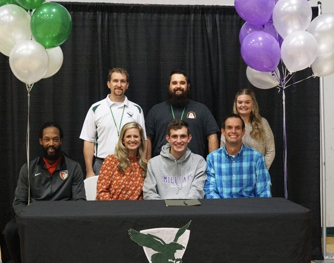 East Hill Christian's Luke Seelmann (front, center) signs with Millsaps during a ceremony at East Hill Christian School on Nov. 13, 2020.