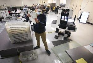Maricopa County Elections employee Charles Cooley tabulates the few thousand remaining ballots at the Maricopa County Elections headquarters in Phoenix, Ariz., on November 12, 2020.