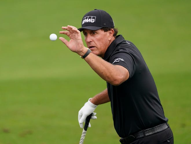 Nov 10, 2020; Augusta, Georgia, USA; Phil Mickelson catches a ball at the practice facility as he prepares for The Masters golf tournament at Augusta National GC. Mandatory Credit: Rob Schumacher-USA TODAY Sports