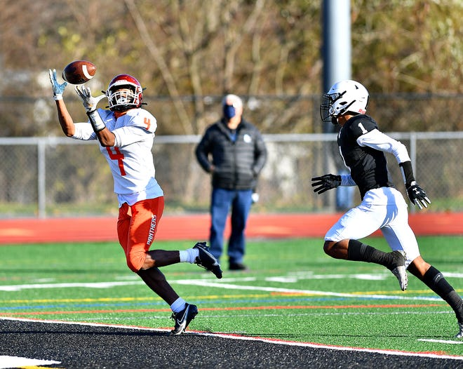 Central York's Judah Tomb catches a pass for a touchdown during a PIAA playoff game vs. Delaware Valley.