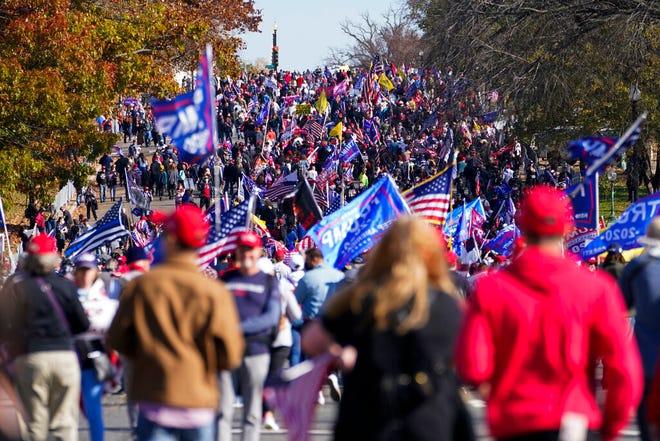 Supporters of President Donald Trump attend pro-Trump marches, Saturday Nov. 14, 2020, in Washington. (AP Photo/Jacquelyn Martin)