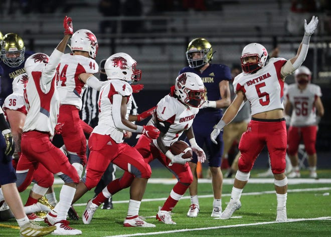 Smyrna's Stephan Driver (1) comes up with a fumble recovery against Salesianum in the inaugural game at Rocco Abessinio Stadium Friday, Nov. 13, 2020.