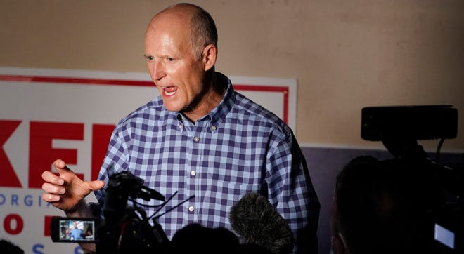 Sen. Rick Scott, R-Fla., speaks to the media after a campaign rally for Republican candidates Sens Kelly Loeffler and Sen. David Perdue, Nov. 13, 2020, in Cumming, Georgia.