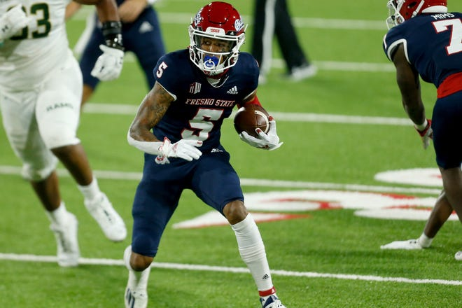 Fresno State wide receiver Jalen Cropper (5) runs with the ball during the first quarter against Colorado State at Bulldog Stadium on Oct. 29, 2020.