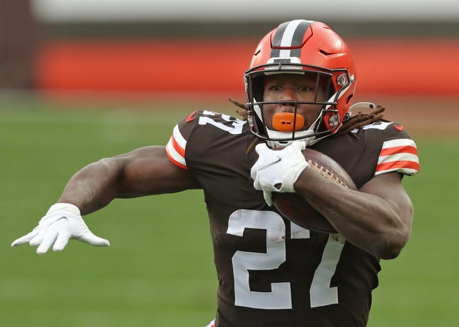 Browns running back Kareem Hunt rushes for yards during the first half Sunday against the Houston Texans in Cleveland.