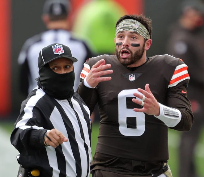 Browns quarterback Baker Mayfield argues with an official after an intentional grounding call on fourth down during the first half Sunday against the Houston Texans in Cleveland.