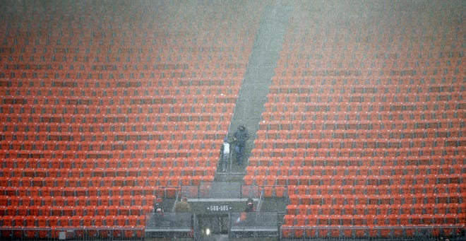Fans were asked to leave the seating area of the stadium as the game was delayed due to weather shortly before Sunday's matchup between the Browns and the Houston Texans in Cleveland.