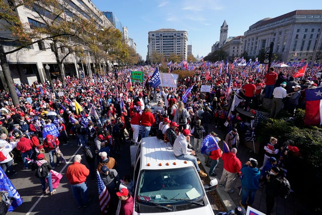 Supporters of President Donald Trump rally at Freedom Plaza on Saturday, Nov. 14, 2020, in Washington. (AP Photo/Julio Cortez)