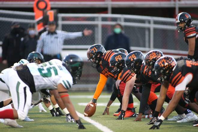 Beaver Falls Offensive Line goes head to head against Sto-Rox's Defensive Line during the first half of the WPIAL 2A Championship Game Saturday night at Martorelli Stadium.