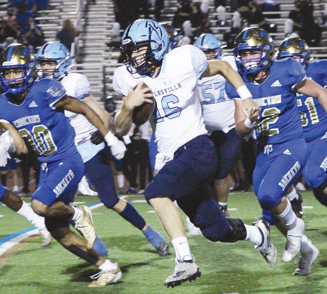 Bartlesville High School senior quarterback Paxton Bradford bolts for a long gain during late-season action.