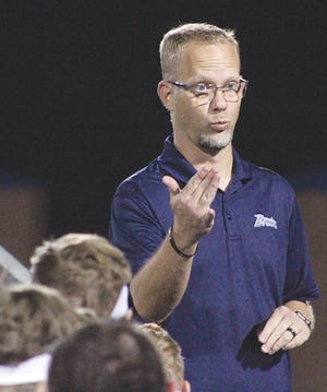Bartlesville High head football coach Jason Sport makes a point to his Bruins in a post game huddle.