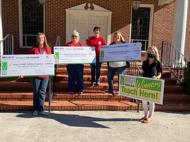Step of Faith Christian Academy teachers (left to right, holding checks) Alisha Coleman Herlong, Karen Creech and Savannah Duke Womble received Bright Ideas grants.