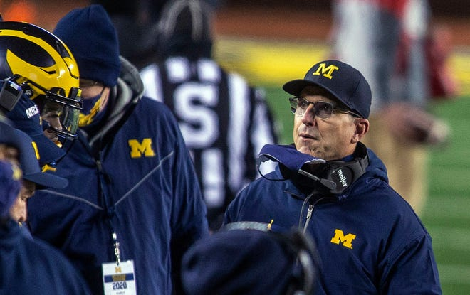 Michigan coach Jim Harbaugh watched his team absorb a 49-11 beating from Wisconsin on Saturday.