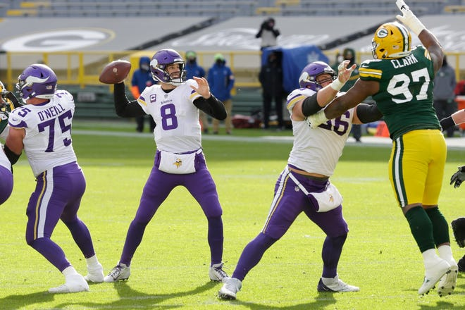 Minnesota's Kirk Cousins throws a pass against the Green Bay Packers on Nov. 1.
