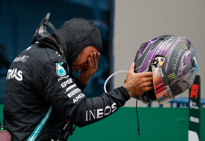 """""""All these emotions were running through me and I was trying to stop it,"""" Lewis Hamilton said in his post-race news conference."""