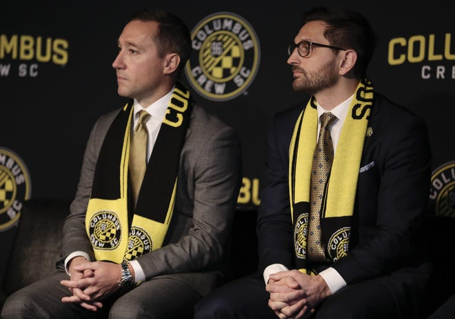 Crew coach Caleb Porter, left, and president/general manager Tim Bezbatchenko have set a high bar since their introductory press conference in January 2019.