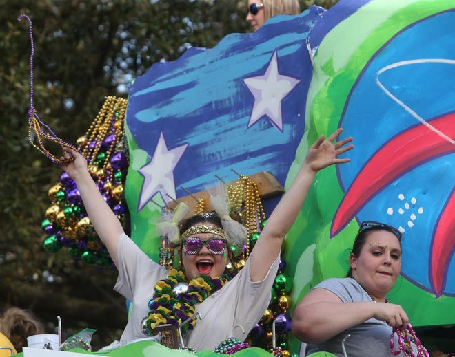 Members of the Krewe of Ambrosia celebrate during its 2019 parade. Authorities are still uncertain if Mardi Gras parades will roll in 2021.