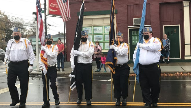 The Wayland Honor Guard stands holding flags to honor the nation's veterans.