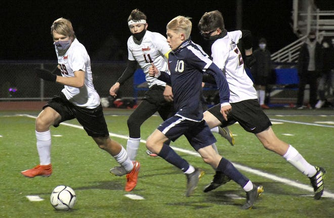 Central Valley Academy's Adin Day (10) is escorted up the field by Vernon-Verona-Sherrill Red Devils Ian Drummond, Sam Donnelly and Nolan Robinson (from left) on a run during the first half of the Tri-Valley League's Pioneer Division soccer championship match Saturday.