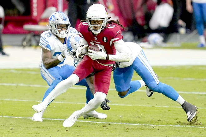 Arizona Cardinals wide receiver DeAndre Hopkins (10) is hit by Detroit Lions outside linebacker Christian Jones during a Sept. 27 game in Glendale, Arizona.