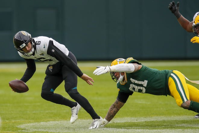 Jaguars' quarterback Jake Luton is chased down and sacked on the team's last possession, which enabled the Green Bay Packers to hold on for a 24-20 win Sunday at Lambeau Field.