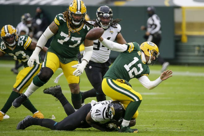 Jaguars' Josh Allen takes down Green Bay Packers' Aaron Rodgers during the second half their game last week. Allen was flagged for roughing the passer. (AP Photo/Mike Roemer)