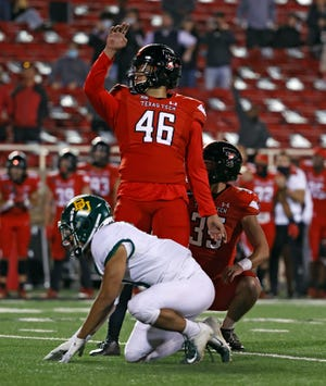 Texas Tech's Jonathan Garibay (46) watches after he kicked a game-winning, 25-yard field goal to help the Red Raiders beat Baylor 24-23 on Saturday at Jones AT&T Stadium. Garibay made all four of his field goals, while also averaging 49.4 yards on five punts.