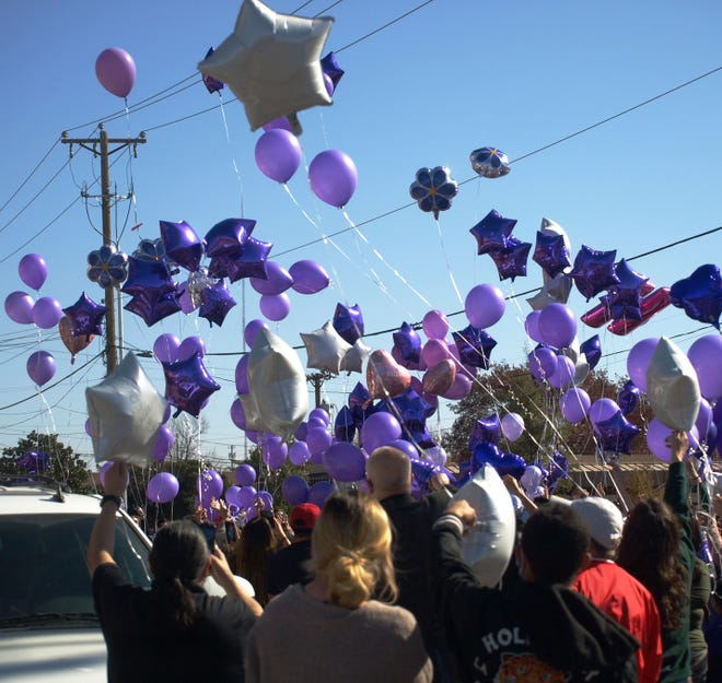 Hundreds purple and white balloons were released Sunday on 70th Street in front of Orlando's Italian Restaurant in honor of Haven Trevino, who was shot to death Thursday by her ex-boyfriend, in front of the restaurant. Family members spoke to the hundreds of people who gathered for the ceremony and urged them to speak out and get involved when they see signs of domestic abuse.